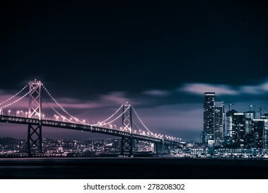 San Francisco Skyline and the Oakland Bay Bridge at Night. California, United States.