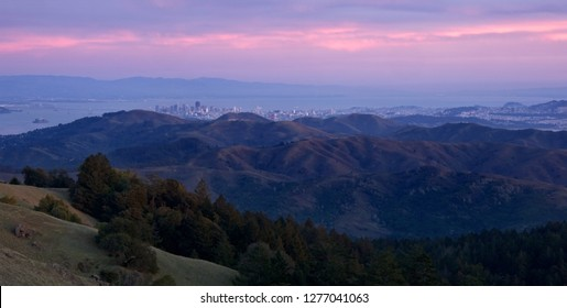 San Francisco Skyline peeping above the mountains from the Marin Headlands at Sunset