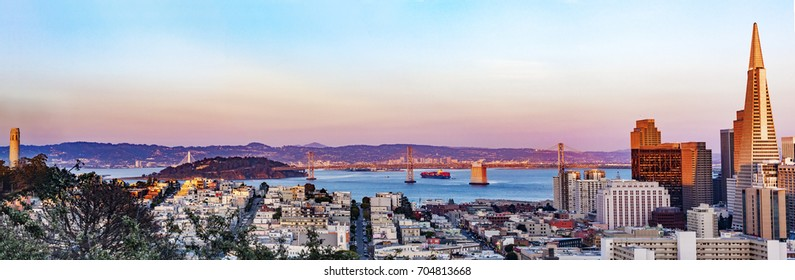 San Francisco Skyline At Sunset Panorama - Bay Bridge & Coit Tower.  California, USA.