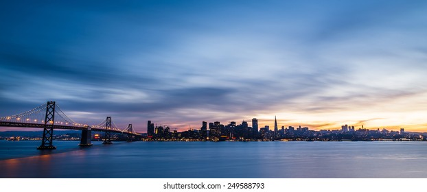 San Francisco skyline at sunset with solo boat