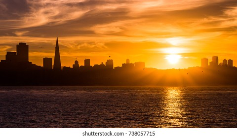 San Francisco skyline at sunset time, a view from Treasure Island across the bay.