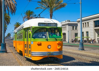 San Francisco streetcar, tram or muni trolley traveling on the Embarcadero down town on a sunny day.  Vintage streetcar originally Los Angeles built in 1946 trolley No 1080.  Tribute livery.