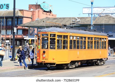 San Francisco, United States - September 21, 2017: Orange vintage Swiss Firsherman's Wharf streetcar in it's Fisherman's Warf station. Fisherman's Wharf is one of the city's busiest tourist areas