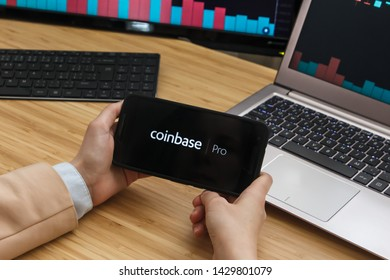 SAN FRANCISCO, US - 18 June 2019: Female Trader Hands Holding the Smartphone Using Application of Coinbase Pro Cryptocurrency Exchange Market. Cryptocurrency Background Concept, San Francisco