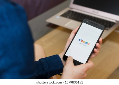 SAN FRANCISCO, US - 22 April 2019: Close up to female hands holding smartphone using Google Search Console Service, San Francisco, California, USA. An illustrative editorial image