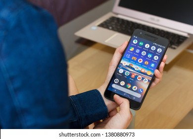 SAN FRANCISCO, US - 22 April 2019: Close up to female hands holding smartphone using Google Services and Applications, San Francisco, California, USA. An illustrative editorial image