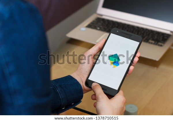 SAN FRANCISCO, US - 22 April 2019: Close up to female hands holding smartphone using Google Family Link application, San Francisco, California, USA. An illustrative editorial image