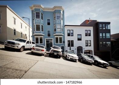 SAN FRANCISCO, USA - APRIL 13: Cars park in a row on a steep hill on April 13, 2013 in San Francisco hill.