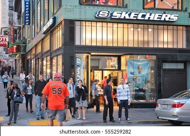 SAN FRANCISCO, USA - APRIL 8, 2014: Shoppers walk by Skechers shoe store in San Francisco, USA. Skechers is an American shoe company with 503 stores.