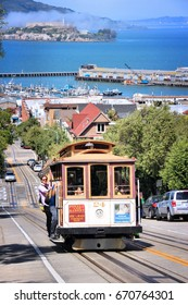 SAN FRANCISCO, USA - APRIL 8, 2014: People ride historic cable car in San Francisco, USA. Famous SF streetcars began operation in 1878.