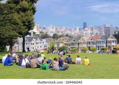 SAN FRANCISCO, USA - APRIL 9, 2014: People visit Alamo Square in San Francisco, USA. San Francisco is the 4th most populous city in California (837,442 people in 2013).