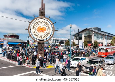 SAN FRANCISCO, USA - AUG 22, Travellers at Fisherman's Wharf of San Francisco. Fisherman's Wharf is a neighborhood and popular tourist attraction in San Francisco, California, USA