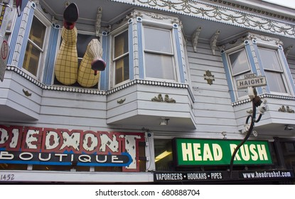 SAN FRANCISCO, USA - AUGUST 12 203: Big Legs with fishnet stockings hanging out of window on Haight Street in San Francisco