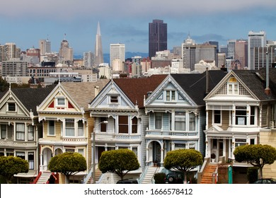 SAN FRANCISCO, USA - AUGUST 2013: the painted ladies, colorful Victorian houses, of Alamo square with San Francisco downtown on the background