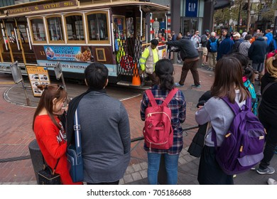 SAN FRANCISCO, USA CALIFORNIA - OCTOBER 09, 2016: San Francisco Cable Car with a tourists at Powell and Market streets