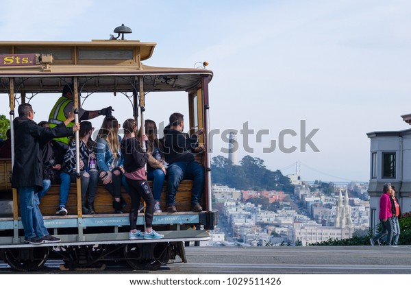SAN FRANCISCO, USA - DECEMBER 2, 2017: People inside a cable car looking down to Lombard street