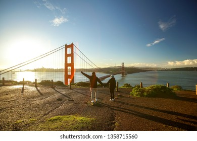 SAN FRANCISCO, USA - February 16, 2019: a couple taking a picture while sunrise around the Golden Gate Bridge, San Farncisco. -Image