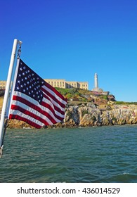 San Francisco: Usa flag and Alcatraz island in the Bay on 7 June 2010. Alcatraz island, now part of Golden Gate National Recreation Area, was developed with a federal prison from 1933 until 1963