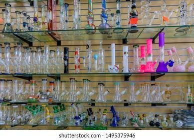 San Francisco, USA - July 04, 2019: Display of glass bongs for smoking medicinal and recreational marijuana or weed, pot in a Haight Ashbury store