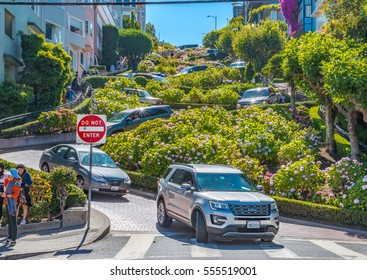 San Francisco USA - July 14, 2015 - Many vehicles drive downhill on Lombard Street, one of the most famous landmark and the crookedest street in the world.