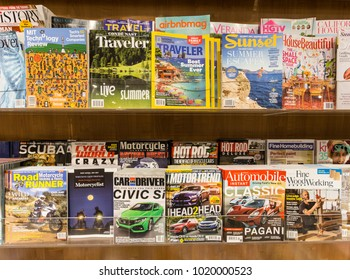 San Francisco, USA - July 2 2017: Magazines of mosty men interest subjects surch as cars, motorcycle and travel are diplayed in the shelf of a bookstore in San Francisco
