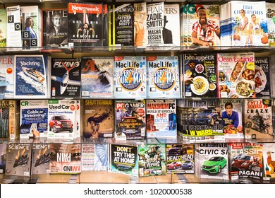 San Francisco, USA - July 2 2017: Magazines of mosty men interest subjects surch as cars, games, sport or news are diplayed in the shelf of a bookstore in San Francisco
