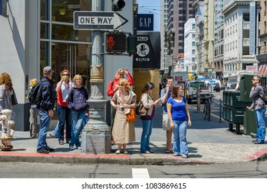 SAN FRANCISCO, USA - JULY 24, 2008: people wait at a pedestrian crossing for green light to cross the street in San Francisco.