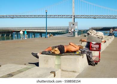 SAN FRANCISCO, USA - JUN 24, 2015: Unknown Homless sleeping at the Promenade.