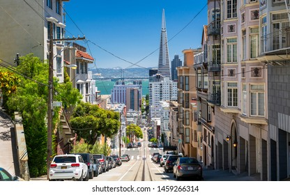 San Francisco, USA - June 11 2018: Street view of Transamerica Pyramid and Oakland Bay bridge San Francisco, California, USA, North America