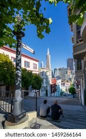 San Francisco, USA - June 12 2018: View of Transamerica Pyramid from Peter Macchiarini Steps, San Francisco, California, United States of America, USA