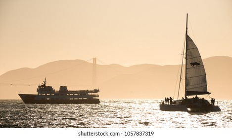 San Francisco, USA - June 24, 2015: Ship near the Golden Gate Bridge in the evening