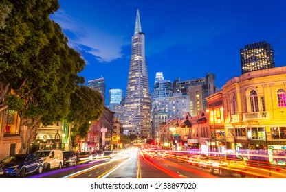San Francisco, USA - June 8 2018: View of Transamerica Pyramid building on Columbus Avenue and car trail lights, San Francisco, California, USA, North America