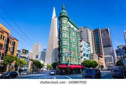 San Francisco, USA - June 8 2018: View of Transamerica Pyramid building and Columbus Tower on Columbus Avenue, North Beach, San Francisco, California, USA, North America