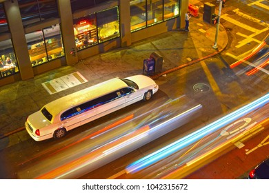 SAN FRANCISCO, USA - March 6, 2016: White extended luxury stretch limousine parking at night on a street of San Francisco, USA.