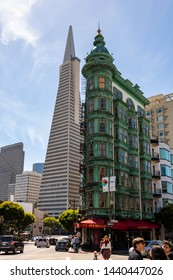 San Francisco, USA - May 27, 2018, landscape of the city street in clear sunny weather with perspective skyscrapers and people walking, Transamerica building and vintage flat green building. Concept
