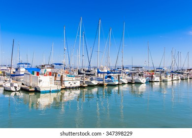 SAN FRANCISCO, USA - OCT 5, 2015: Yacht boats at Pier 39 of San Francisco. Pier 39 is a shopping center and popular tourist attraction built on a pier in San Francisco, California