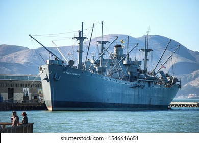SAN FRANCISCO, USA - OCTOBER 18TH, 2019: The Fisherman's wharf in San Francisco with the SS Jeremiah O'Brien, famous tourist attraction in the bay.