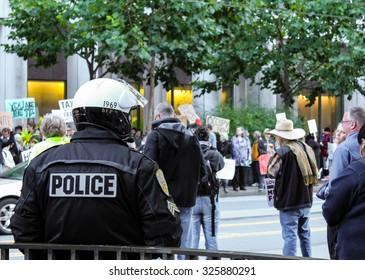San Francisco, USA - October 7: San Francisco police looking at the protestor at Market Street on October 7, 2011 in San Francisco, USA.