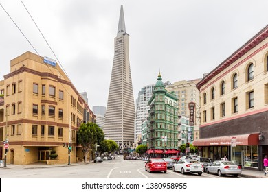 SAN FRANCISCO, USA - SEPTEMBER 3, 2016: Central San Francisco with famous Transamerica Pyramid and historic Sentinel Building at Columbus Avenue on a cloudy day, California, USA