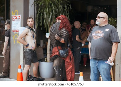 San Francisco, USA - September 30, 2013: Unidentified people at the annual gay festival Folsom Street Fair in San Francisco, everyone is happy, having fun, and wear Carnival clothing