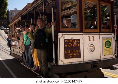 SAN FRANCISCO, USA-June 20, 2017: Japanese tourists greet photographers from San Francisco streetcars on June 20, 2017