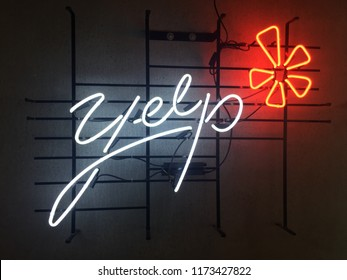San Francisco,CA August 22 2018: Neon Lighting Yelp Internet Review company logo at Yelp Headquarters Cafateria