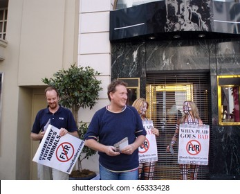 SAN FRANCISCO,CA - AUGUST 31: People protest retail store about Fur with girls in plaid patterned body paint and men passing out handouts holding signs August 31, 2007 Union Square, San Francisco.