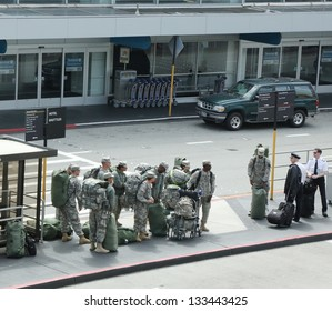 SAN FRANCISCO,CA - MARCH 29: American soldiers returning home from duty in San Fransisco Airport on March 29, 2013.