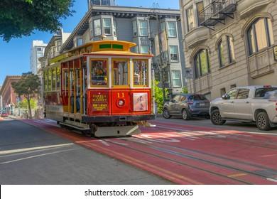 San Francisco,California, USA - April 20, 2018 : Passengers enjoy a ride on a cable car on April 20, 2018 in San Francisco,California.