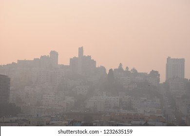 San Francisco,California,United States - November,16,2018 - Aerial haze view of Lombard Street with building in smoke produced by wildfire. Very unhealthy toxic fire air pollution