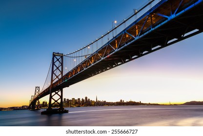 San Francisco-Oakland Bay Bridge and cityscape at sunset