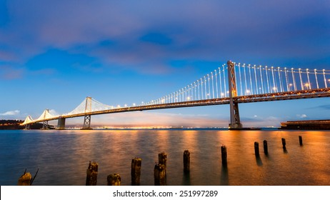 San Francisco-Oakland Bay Bridge illuminated at sunset