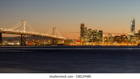 San Francisco's Bay Bridge and City Lights. Treasure Island, California, USA