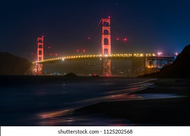 San Francisco's iconic Golden Gate Bridge is viewed from Baker Beach after nightfall.